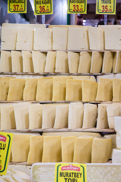 Blocks of tasty cheese sit out on display for sale at Istanbul Spice bazaar in Turkey