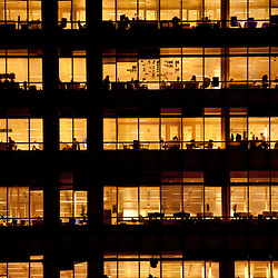 People work in an office building in London on November 1, 2013. Full-time employees in the UK work longer hours than the EU average, according to the Office for National Statistics.