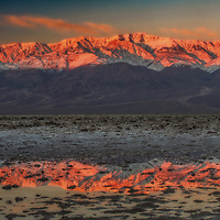 Winter sunrise on the Panamint Mountains from Badwater Basin in Death Valley National Park, California.