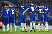 Chelsea players watch as Chelsea defender David Luiz (30) takes his penalty, during the EFL Cup semi final second leg match between Chelsea and Tottenham Hotspur at Stamford Bridge, London, England on 24 January 2019.