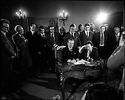 29/03/1976<br /> 03/29/1976<br /> 29 March 1976<br /> Petroleum exploration licences signed at Iveagh House, Dublin. Minister for Industry and Commerce, Mr Justin Keating T.D. and senior oil company executives representing the firms to which licences were being granted signed petroleum exploration licences in respect of exploration offshore of Ireland. Image shows The Minister (seated right) signing the licence with Dr Jack Birks, Head of Exploration B.P., representing the Aran BP group consisting of BP, Aran Energy Ltd., Saga and Shenandoah Ireland Inc.