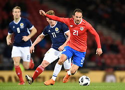 Costa Rica's Maecos Urena with Scotland's Matt Ritchie behind during the international friendly match at Hampden Park, Glasgow. RESTRICTIONS: Use subject to restrictions. Editorial use only. Commercial use only with prior written consent of the Scottish FA.