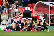 Brentford midfielder, Sam Saunders (7) celebrating scoring opening goal 1-0 during the Sky Bet Championship match between Brentford and Fulham at Griffin Park, London, England on 30 April 2016. Photo by Matthew Redman.