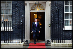 Prime Minister David Cameron waits to welcome the President of the Republic of Korea Her Excellency Park Geun-hye at No10 Downing Street, London, United Kingdom. Wednesday, 6th November 2013. Picture by Andrew Parsons / i-Images