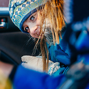 Jade Goodrich pokes her head out for a look before departing for a day of skiing at Jackson Hole Mountain Resort in Teton Village, Wyoming.