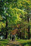 Image of two friends walking together in Forest Park, St. Louis, Missouri, American Midwest