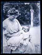 happy smiling mother with baby toddler France ca 1920s