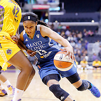 17 June 2014: Minnesota Lynx forward Maya Moore (23) drives to the basket past Los Angeles Sparks center Jantel Lavender (42) during the Minnesota Lynx  94-77 victory over the Los Angeles Sparks, at the Staples Center, Los Angeles, California, USA.