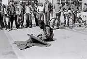 Man plays a santoor on the street, London, UK, 1982