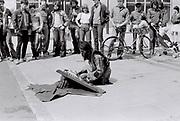 Man plays a santoor on the street, London, UK, 1982