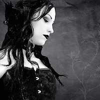 Pale female wearing a corset with long hair looking over the shoulder