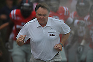 Ole Miss head coach Houston Nutt leads the team onto the field at Vaught-Hemingway Stadium in Oxford, Miss. on Saturday, September 3, 2011. BYU won 14-13.