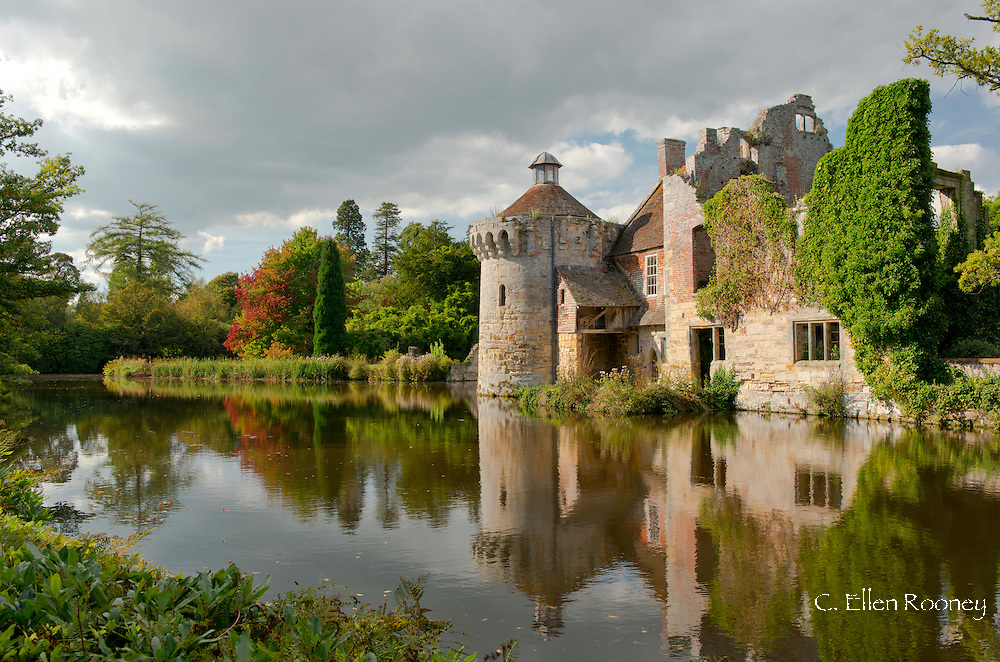 Autumn reflections in a lake at Scotney Castle, Tunbridge Wells, Kent, UK