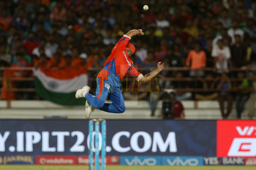 Gujarat Lions captain Suresh Raina jumps to take the catch of Krunal Pandya of the Mumbai Indians during match 35 of the Vivo 2017 Indian Premier League between the Gujarat Lions and the Mumbai Indians  held at the Saurashtra Cricket Association Stadium in Rajkot, India on the 29th April 2017<br /> <br /> Photo by Vipin Pawar - Sportzpics - IPL