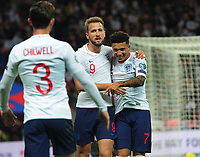 Football - 2019 / 2020 UEFA European Championships Qualifier - Group A: England vs. Montenegro<br /> <br /> Harry Kane of England celebrates scoring the third goal, with Jadon Sancho at Wembley Stadium.<br /> <br /> This game is England men's 1,000 international match.<br /> <br /> COLORSPORT/ANDREW COWIE<br /> <br /> Jadon Sancho
