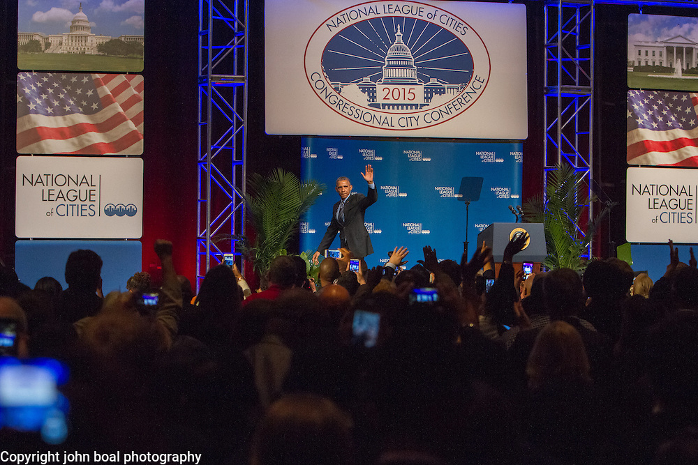 President Obama bids farewell after his address at the National League of Cities Congressional City Conference, at the Marriott Wardman Park Hotel, on Monday, March 9, 2015.  During the speech President Obama unveiled his new Tech Hire Initiative which aims to provide training and jobs for Americans looking to find work in the high tech industry.  John Boal Photography