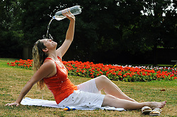 As the heatwave continues this  Sandra Findley from Orpington in Kent cools herself in the The Priory Gardens in Orpington near Bromley. Photo credit :Grant Falvey/LNP