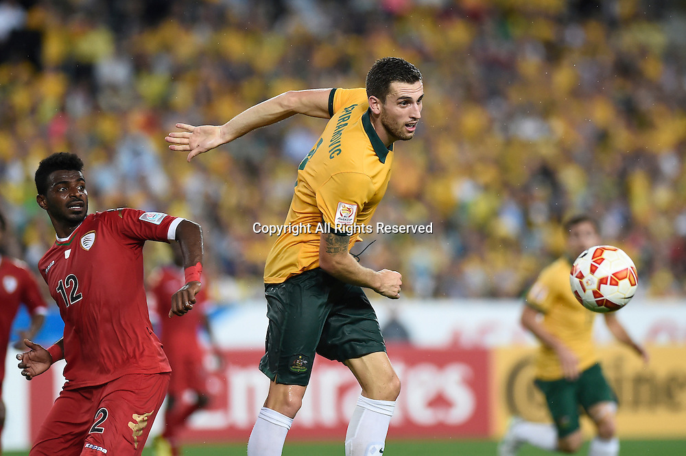 13.01.2015.  Sydney, Australia. AFC Asian Cup Group A. Australia versus Oman. Australian defender Matthew Spiranovic in heading action. Australia won the game 4-0.