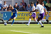 AFC Wimbledon midfielder Scott Wagstaff (7) crossing the ball during the EFL Sky Bet League 1 match between AFC Wimbledon and Shrewsbury Town at the Cherry Red Records Stadium, Kingston, England on 14 September 2019.
