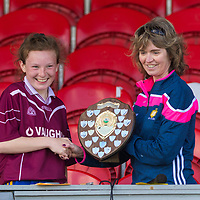 Tara Connolly is presented with the Division 3 shield by Aideen O'Mahoney.<br /> <br /> Lisdoonvarna Parish Schools v Scoil Réalt na Mara, Kilkee/Moyasta NS, in Division 3  Clare Primary Schools Ladies Football Finals at Cusack Park, Ennis, Co. Clare