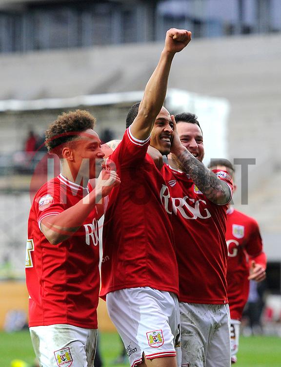 Peter Odemwingie of Bristol City celebrates with Bobby Reid and Lee Tomlin of Bristol City  - Mandatory byline: Joe Meredith/JMP - 19/03/2016 - FOOTBALL - Ashton Gate - Bristol, England - Bristol City v Bolton Wanderers - Sky Bet Championship