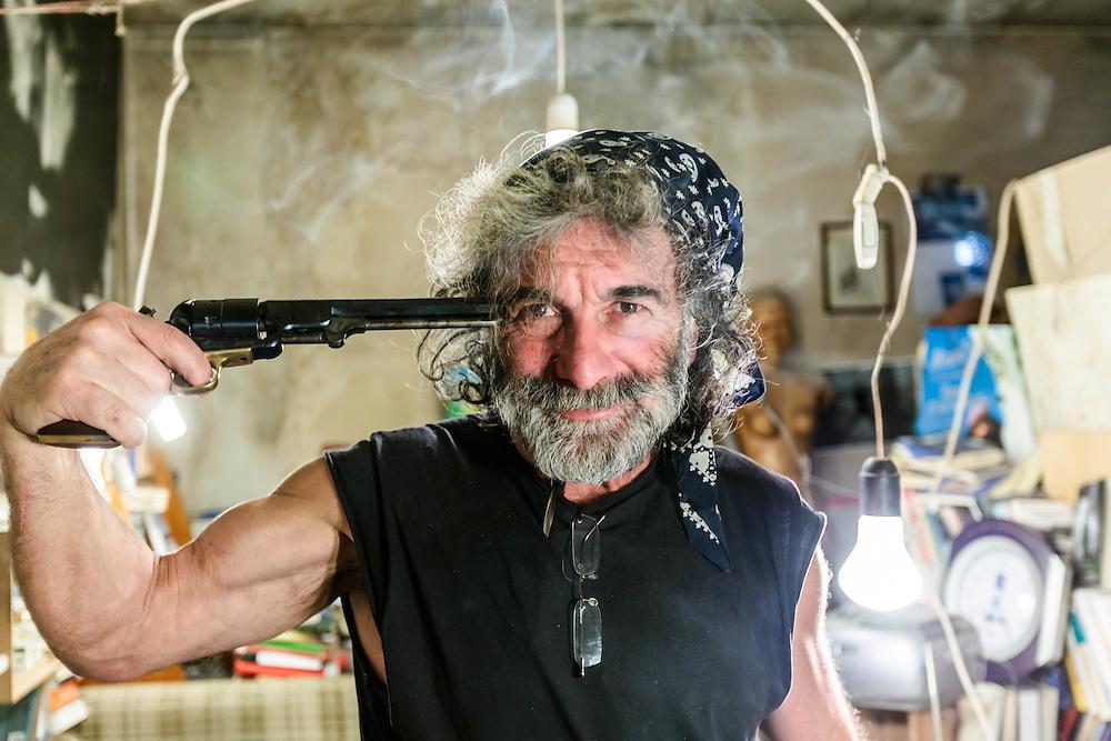 02 FEB 2011 - Erto (PN) - Mauro Corona, scrittore, alpinista e scultore, nel suo studio :-: Italian writer, climber and carver Mauro Corona at his place