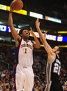 Nov. 3 2010; Phoenix, AZ, USA; Phoenix Suns guard Josh Childress (1) puts up a basket during the first half against San Antonio Spurs guard Manu Ginobili (20) at the US Airways Center. Mandatory Credit: Jennifer Stewart-US PRESSWIRE