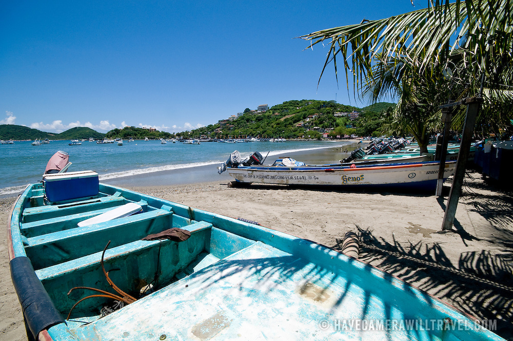 Fishing boats on the shore at Playa Principal at Zihuatanejo, Mexico