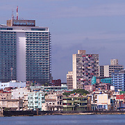 Skyline of Havana shows the Habana Libre Hotel, formerly the Habana Hilton before it was nationalized by the Castro government in 1960. Buildings mostly in disrepair is home to a lot of Cubans in Havana. Some buildings are improved as the economic situation improves. <br /> <br /> Photography by Jose More