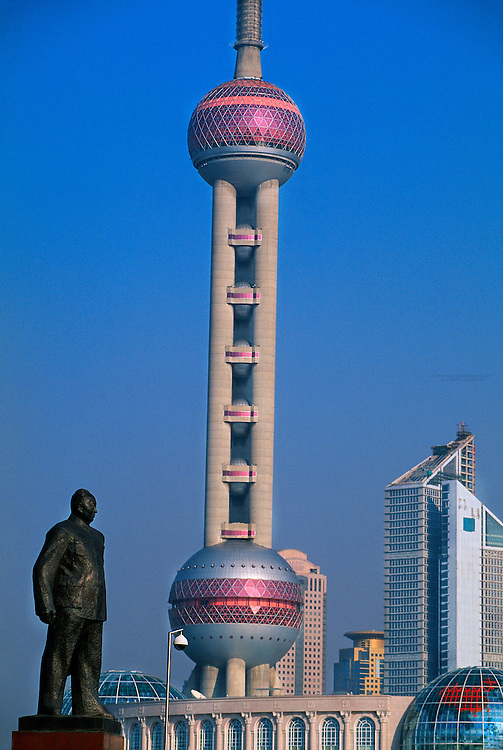 Statue of Mao Zedong in Huangpu Park (on the Bund) with Pudong in background, Shanghai, China