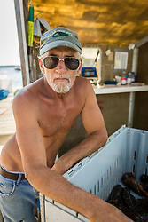 Wharf worker, David Cushman (aka Quazy,) at the Spruce Head Fisherman's Co-op in South Thomaston, Maine.