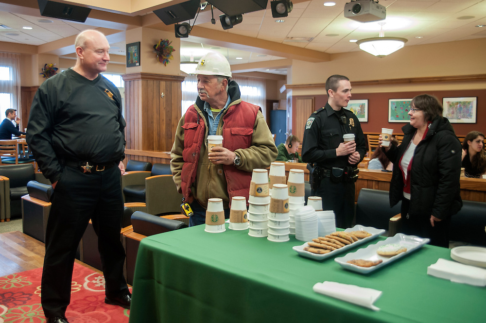 "(In order from left) Sheriff Rodney Smith, Robert P. Boggs, Lieutenant Tim Ryan, and Victoria McFadden enjoy free coffee in The Front Room Coffee House on Thursday, January 22 for ""Coffee with a Cop."" The event encouraged members of the commuity to spend time getting aquainted with law enforcement officials."