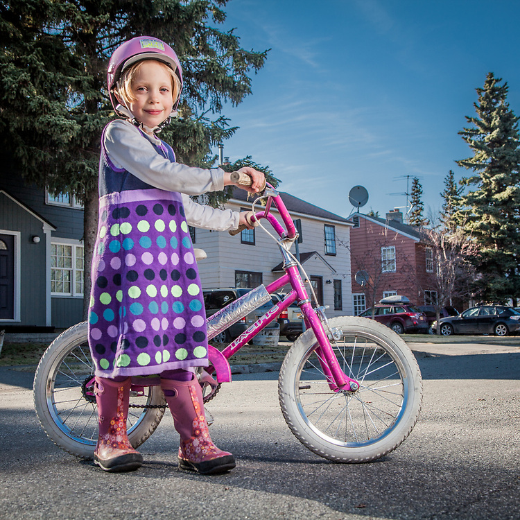 Ellie Cutting, age 6, on her bicycle on H Street, South Addition, Anchorage