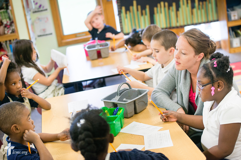 Kindergarten teacher Jennifer Everett helps students during class at the Renaissance School, part of Lutheran Urban Mission Initiative, Inc., on Wednesday, May 20, 2015, in Mt. Pleasant, Wis. LCMS Communications/Erik M. Lunsford