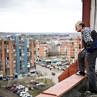 "Pristina, Kosovo 17 February 2011<br /> A man looks at the city from the roof of building in Pristina.<br /> After the Kosovo War and the 1999 NATO bombing of Yugoslavia, the territory of Kosovo came under the interim administration of the United Nations Mission in Kosovo (UNMIK), and most of those roles were assumed by the European Union Rule of Law Mission in Kosovo (EULEX) in December 2008. <br /> In February 2008 individual members of the Assembly of Kosovo declared Kosovo's independence as the Republic of Kosovo. Its independence is recognised by 75 UN member states. <br /> On 8 October 2008, upon request of Serbia, the UN General Assembly adopted a resolution asking the International Court of Justice for an advisory opinion on the issue of Kosovo's declaration of independence.<br /> On 22 July 2010, the ICJ ruled that Kosovo's declaration of independence did not violate international law, which its president said contains no ""prohibitions on declarations of independence"".<br /> Photo: Ezequiel Scagnetti"