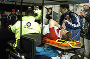 LIONS CAPTAIN BRIAN O'DRISCOLL LIES IN AGONY ON THE MOBILE STRETCHER AS IT LEAVES THE STADIUM AFTER HAVING HIS SHOULDER WAS DISLOCATED IN AN INCIDENT WITH ALL BLACK CAPTAIN TANA UMAGA.NEW ZEALAND V BRITISH & IRISH LIONS, 1ST TEST, JADE STADIUM, CHRISTCHURCH, NEW ZEALAND, SATURDAY 25TH JUNE 2005.