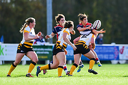 Caity Mattinson of Bristol Ladies offloads despite the tackle of Lousie Dodd of Wasps Ladies  - Mandatory by-line: Craig Thomas/JMP - 28/10/2017 - RUGBY - Cleve RFC - Bristol, England - Bristol Ladies v Wasps Ladies - Tyrrells Premier 15s