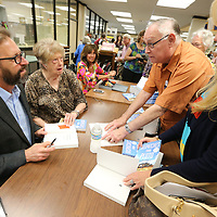 "Richard Grant begins signing his book ""Dispatches rom Pluto"" following Wednesday's Tupelo Read's event at the Lee County Library."