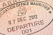Passport page with Mauritius immigration control departure stamp with traditional Dodo bird depicted on it.