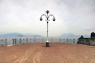 A view from the terrace along the lake Maggiore in Stresa, Piedmont, Italy, on a cold and hazy autumn morning. Stitched from five vertical frames.
