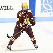 Michael Brodzinski #20 of the Minnesota Gophers is seen on the ice prior to the game against the Northeastern Huskies at Matthews Arena on November 29, 2014 in Boston, Massachusetts. (Photo by Elan Kawesch)