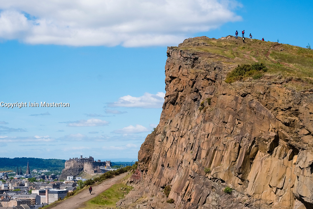 View of Salisbury Crags above the city of Edinburgh in Scotland, UK