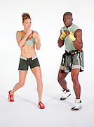 Billy Blanks and an associate perform at a Tae Bo workout session on December 8, 2004 in Sherman Oaks, California. ©Paul Anthony Spinelli