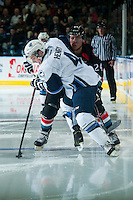 KELOWNA, CANADA - DECEMBER 3: Tyson Baillie #24 of Kelowna Rockets checks Adam Henry #4 of Saskatoon Blades on December 3, 2014 at Prospera Place in Kelowna, British Columbia, Canada.  (Photo by Marissa Baecker/Shoot the Breeze)  *** Local Caption *** Tyson Baillie; Adam Henry;