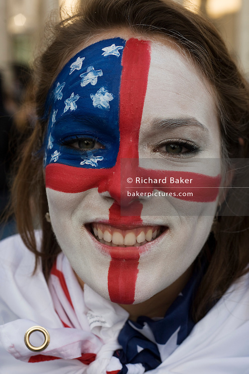 Young woman with painted face of both US and English flags during both countries opening World Cup group match.
