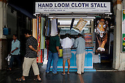 Hand loom shops sell pillows, clothes, hosiery and towels at Erode Junction stn., Tamil Nadu on 9th July 2009.. .6318 / Himsagar Express, India's longest single train journey, spanning 3720 kms, going from the mountains (Hima) to the seas (Sagar), from Jammu and Kashmir state of the Indian Himalayas to Kanyakumari, which is the southern most tip of India...Photo by Suzanne Lee / for The National