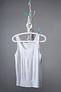 white t-shirts hanging on clothing hanger