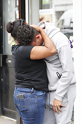 © Licensed to London News Pictures. 12/07/2019. London, UK. Unidentified friends are overcome with grief at the scene where a mass brawl took place in Purley, south London ending with a teenager murdered and two others injured, including the murder suspect. Photo credit: Peter Macdiarmid/LNP