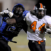 East Bladen's Farrell Murchison tackles Wallace-Rose Hill's Kiese Ashe. (Jason A. Frizzelle)