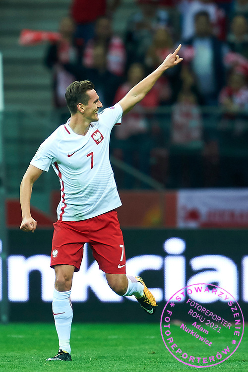 Warsaw, Poland - 2017 September 04: Arkadiusz Milik from Poland celebrates after scoring during soccer match Poland v Kazakhstan - FIFA 2018 World Cup Qualifier at PGE National Stadium on September 04, 2017 in Warsaw, Poland.<br /> <br /> Adam Nurkiewicz declares that he has no rights to the image of people at the photographs of his authorship.<br /> <br /> Picture also available in RAW (NEF) or TIFF format on special request.<br /> <br /> Any editorial, commercial or promotional use requires written permission from the author of image.<br /> <br /> Mandatory credit:<br /> Photo by &copy; Adam Nurkiewicz / Mediasport